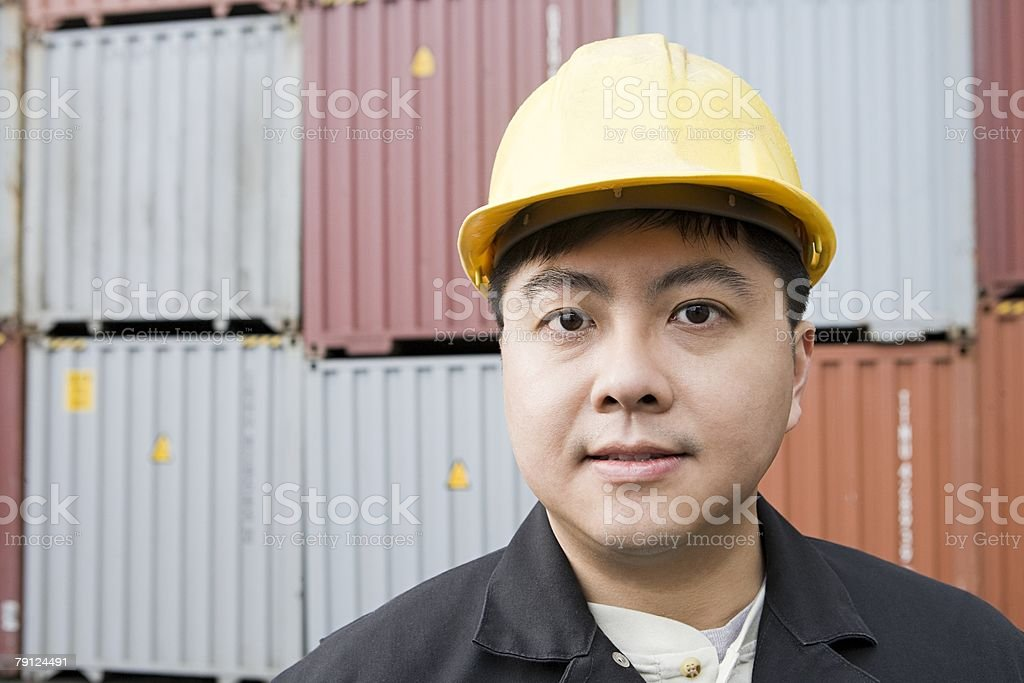 Man at container terminal royalty-free 스톡 사진