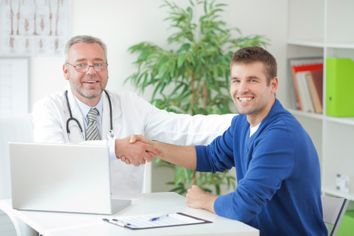 Man At Doctors Office Stock Photo - Download Image Now