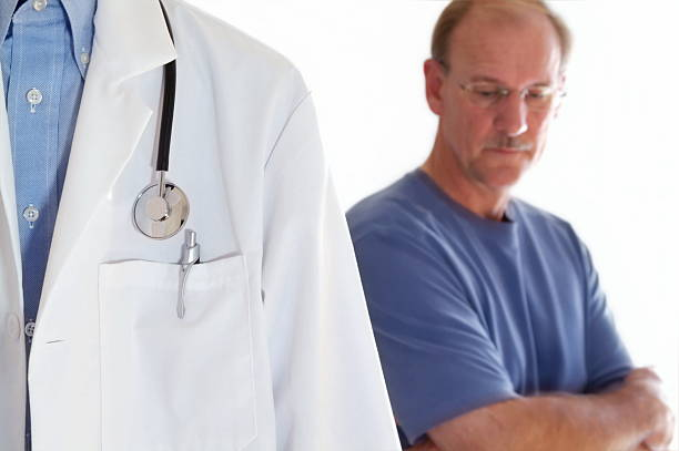 Man at Doctor's Visit stock photo