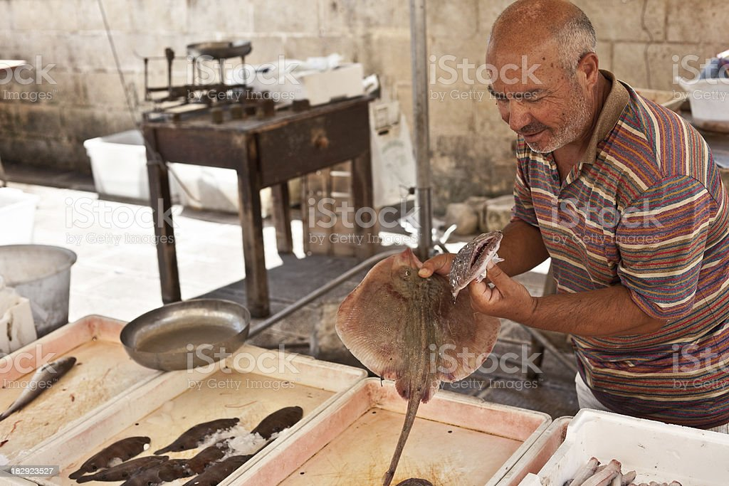 Man At Fish Market royalty-free stock photo