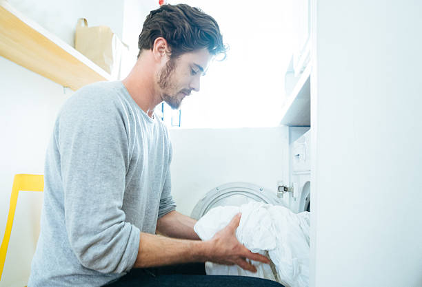 Man At Home Doing Laundry stock photo