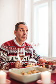 man at home eating alone for christmas