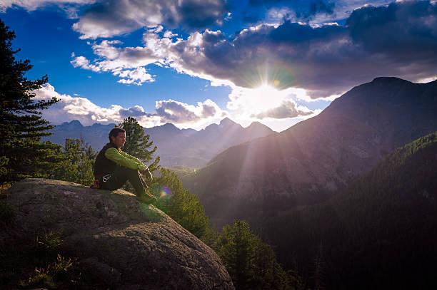 Man at mountain sunrise stock photo