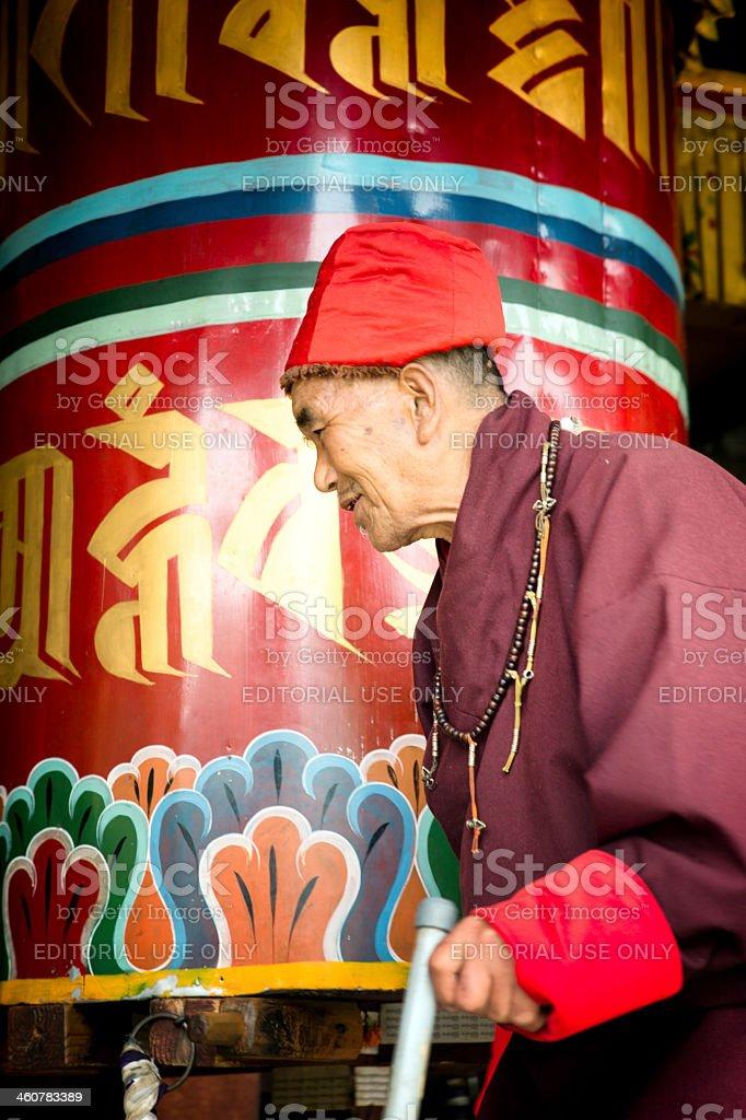 Man at prayer wheel royalty-free stock photo
