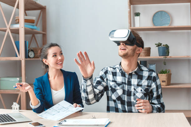 Man at real estate agency sitting in virtual reality headset looking picture id1131883362?b=1&k=6&m=1131883362&s=612x612&w=0&h=mhfjrfciulmqwwzep k2sa9cz8rlemtcjxiebawzdpk=