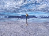 The Salar de Uyuni is located in Bolivia's Altiplano, ear the crest of the Andes and is at an elevation of 3,656 meters (11,995 ft) above sea level.\n\nDuring the rainy season, a thin layer of water transforms the flats into a stunning reflection of the sky, making a beautiful mirror effect.
