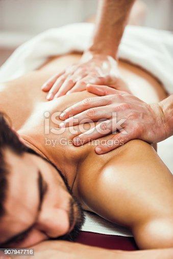 istock Man at spa massage 907947716