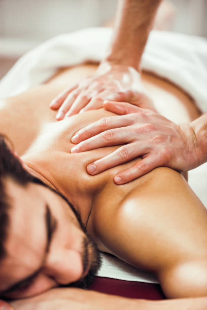 man at spa massage - human limb stock pictures, royalty-free photos & images