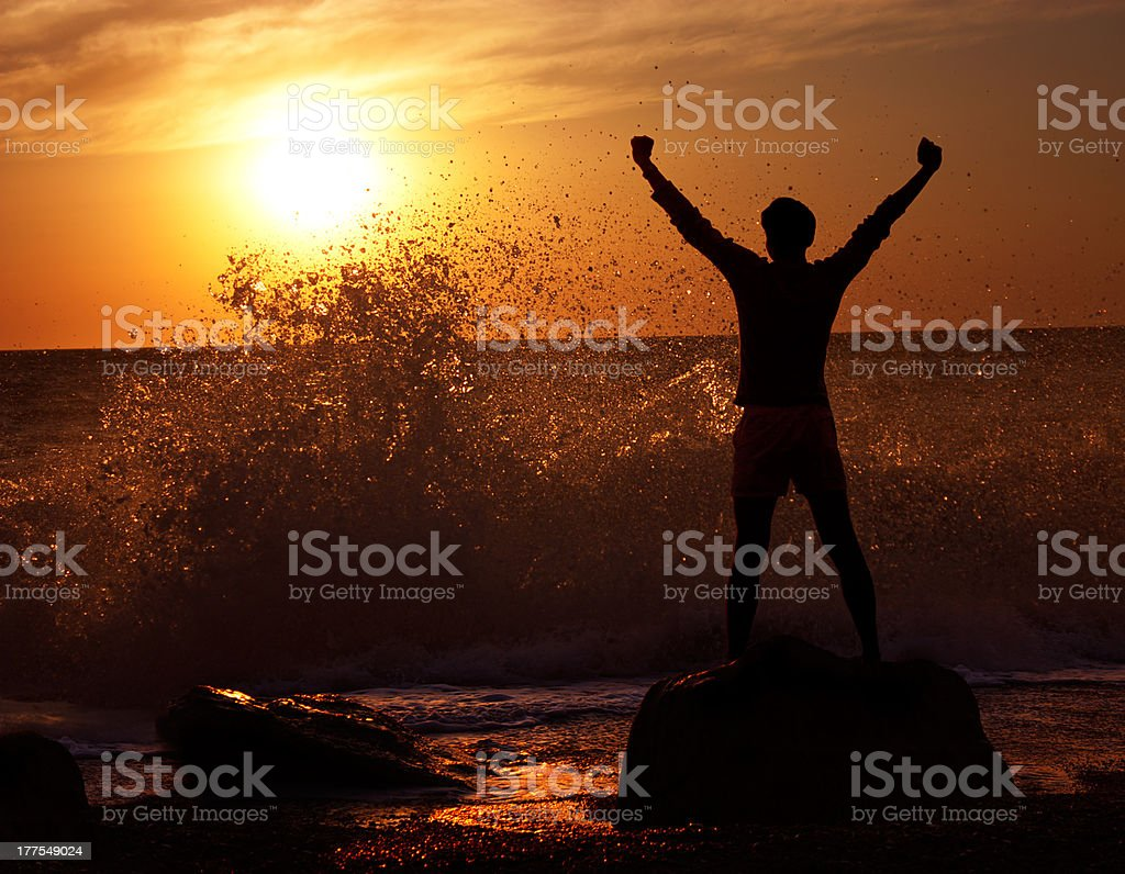 Man at Stormy Sea on Sunset stock photo