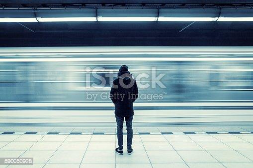 istock Man at subway station 590050928