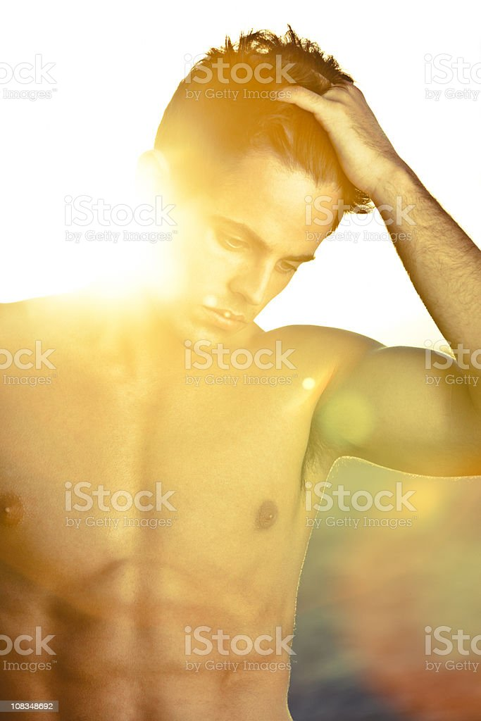 Man at sunset stock photo