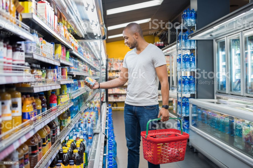 Man at supermarket stock photo