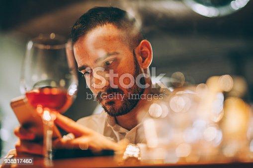 istock Man at the bar 938317460