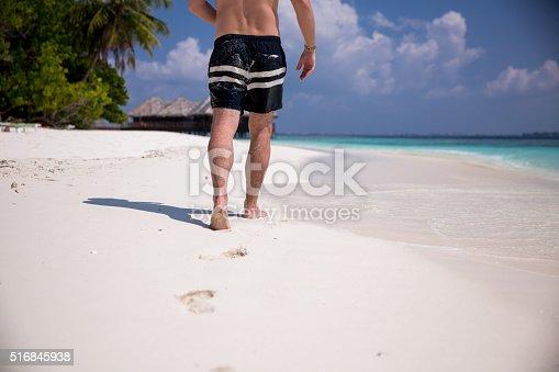 174919648 istock photo Man at the beach 516845938