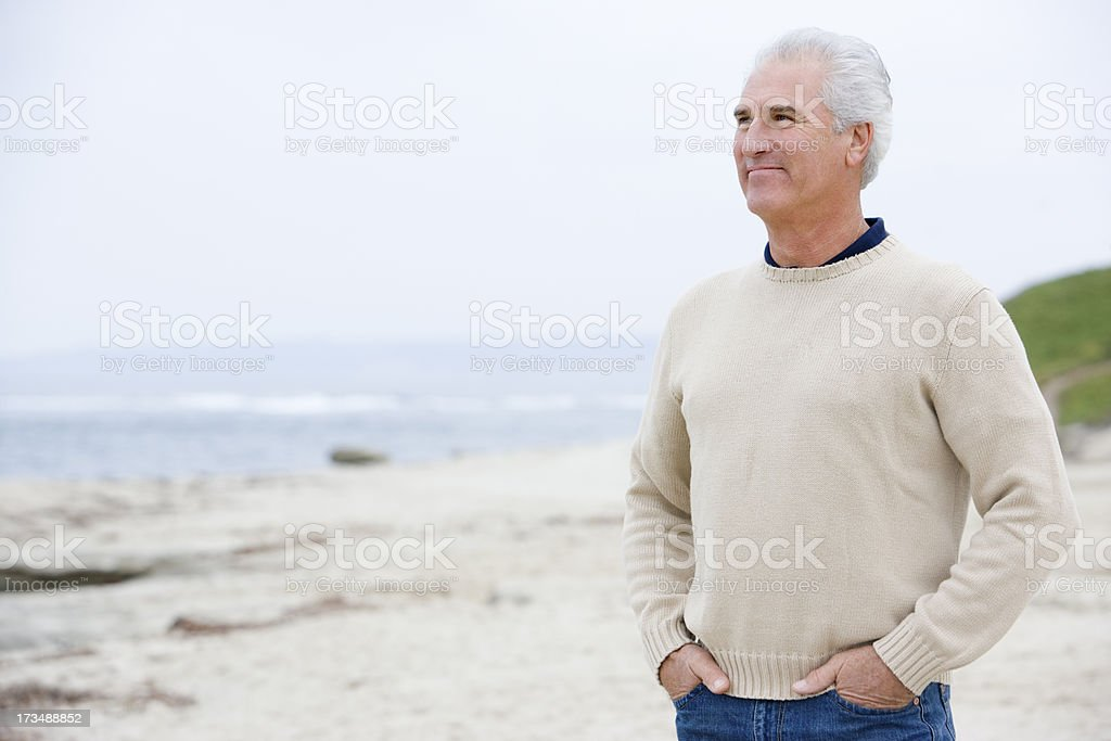 Man at the beach with hands in pockets royalty-free stock photo