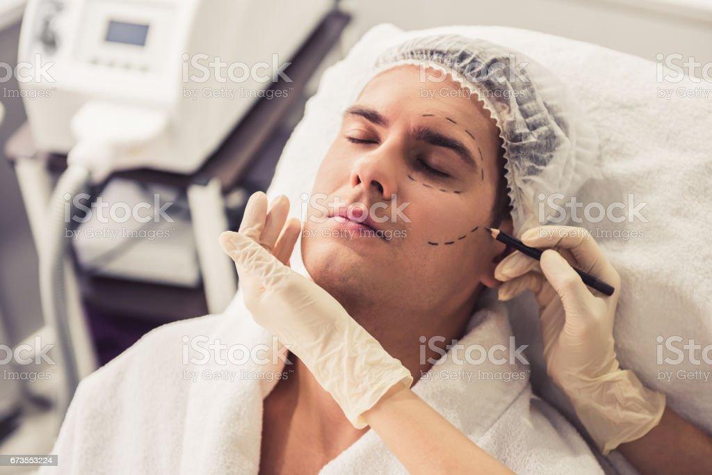 Man at the beautician stock photo