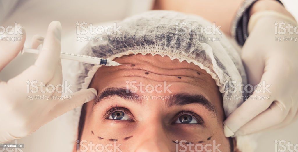 Man at the beautician - foto stock
