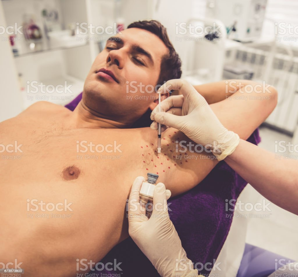Man at the beautician stock photo