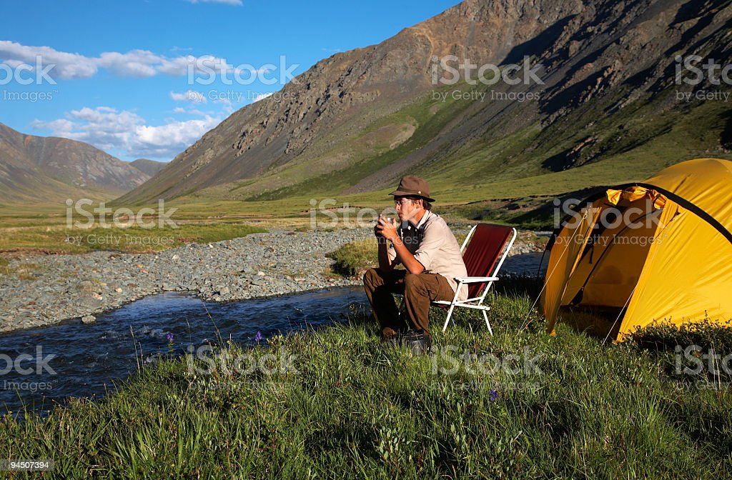 man at the camp stock photo
