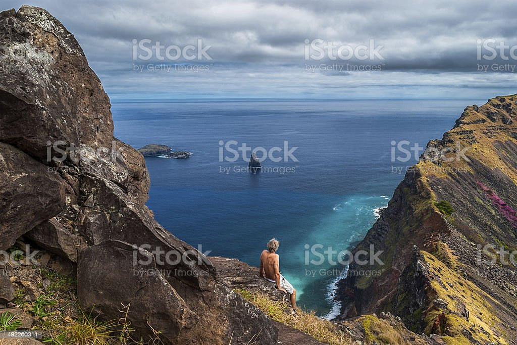 Man at the crater of Rano Kao, Easter Island, Chile. stock photo