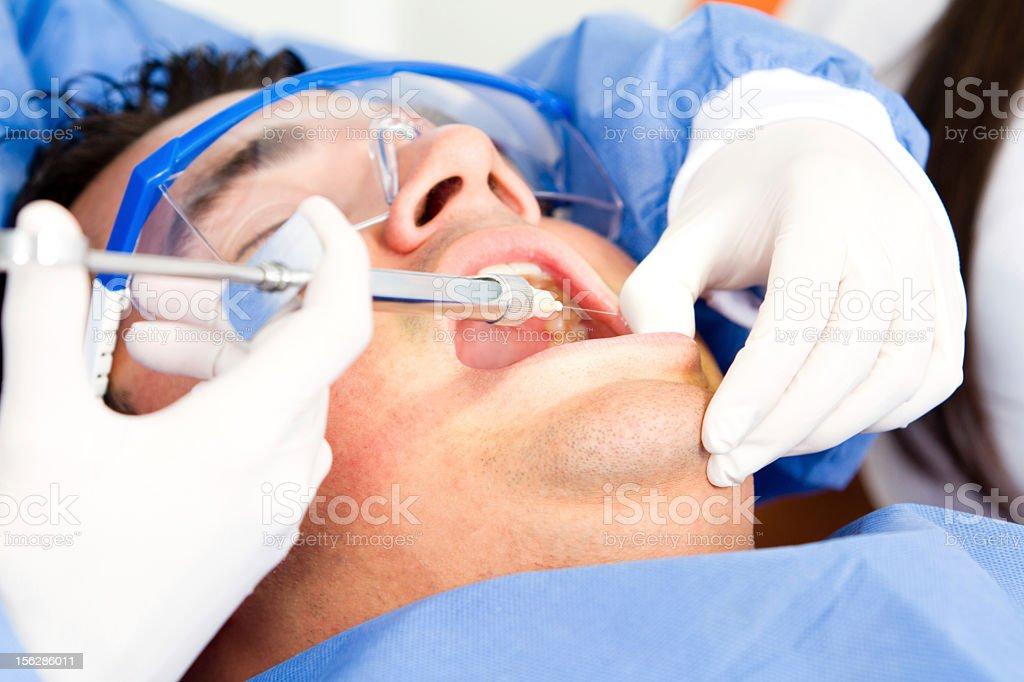 Man at the dentist stock photo