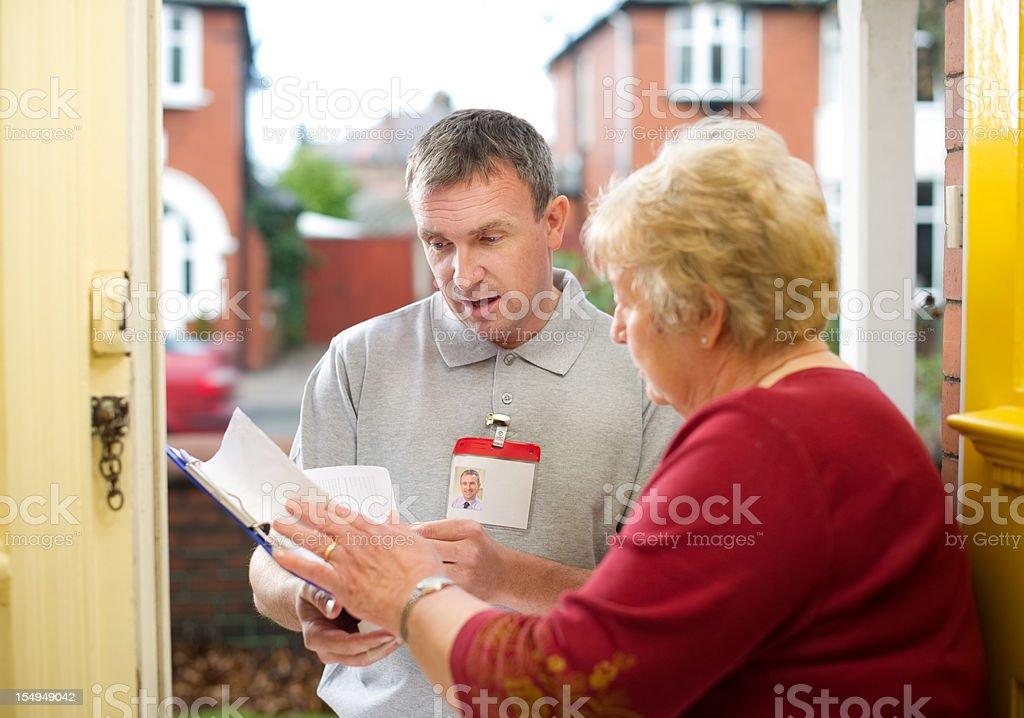 man at the door stock photo