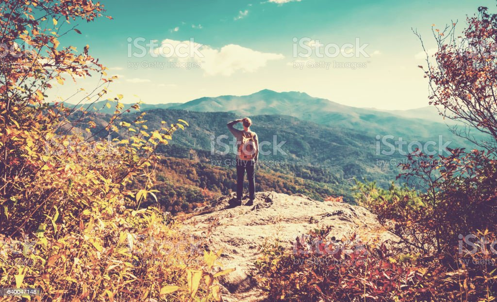 Man at the edge of a cliff stock photo