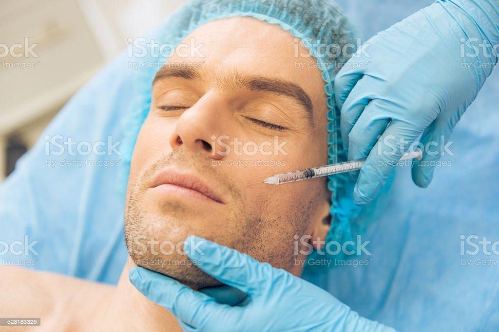 Man at the plastic surgeon stock photo