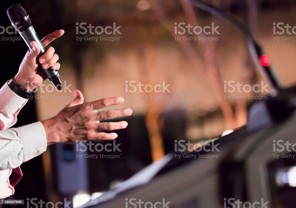 Man at the stage, giving speech stock photo