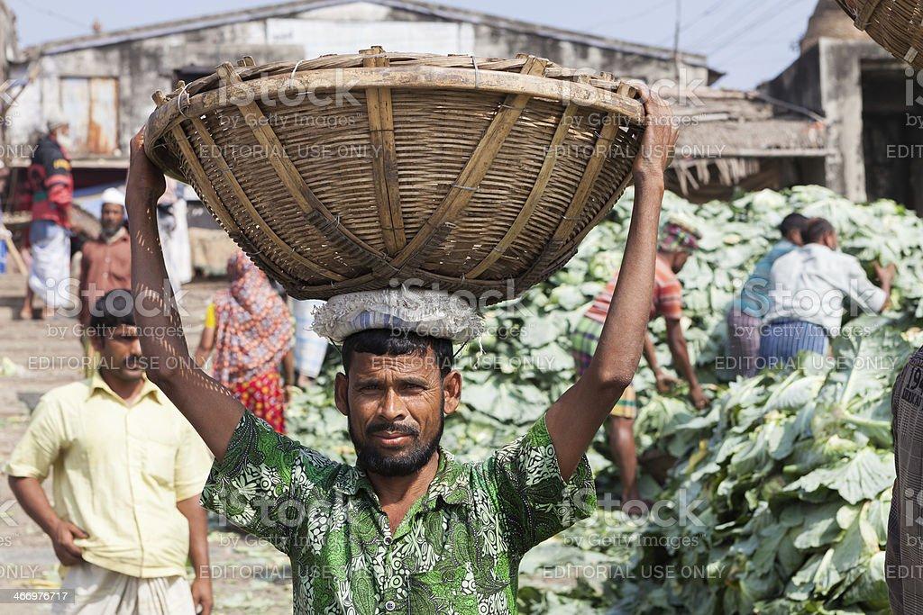 Man at vegetable market in Dhaka stock photo