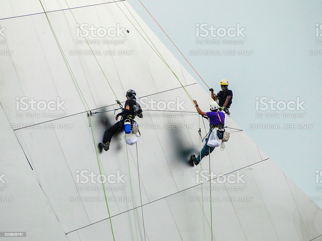 man at work high up the ArtScience Museum in Singapore stock photo