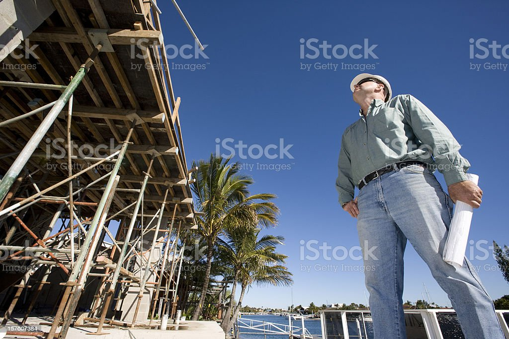 Man at work looking at a construction site stock photo