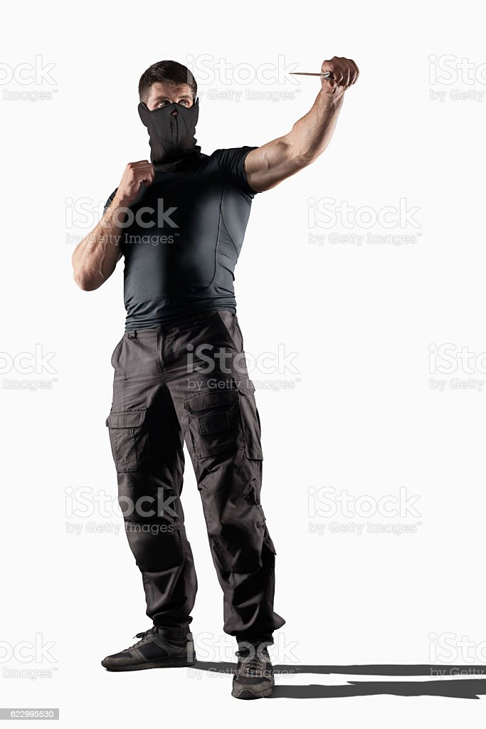 Man atacking with knife isolated stock photo