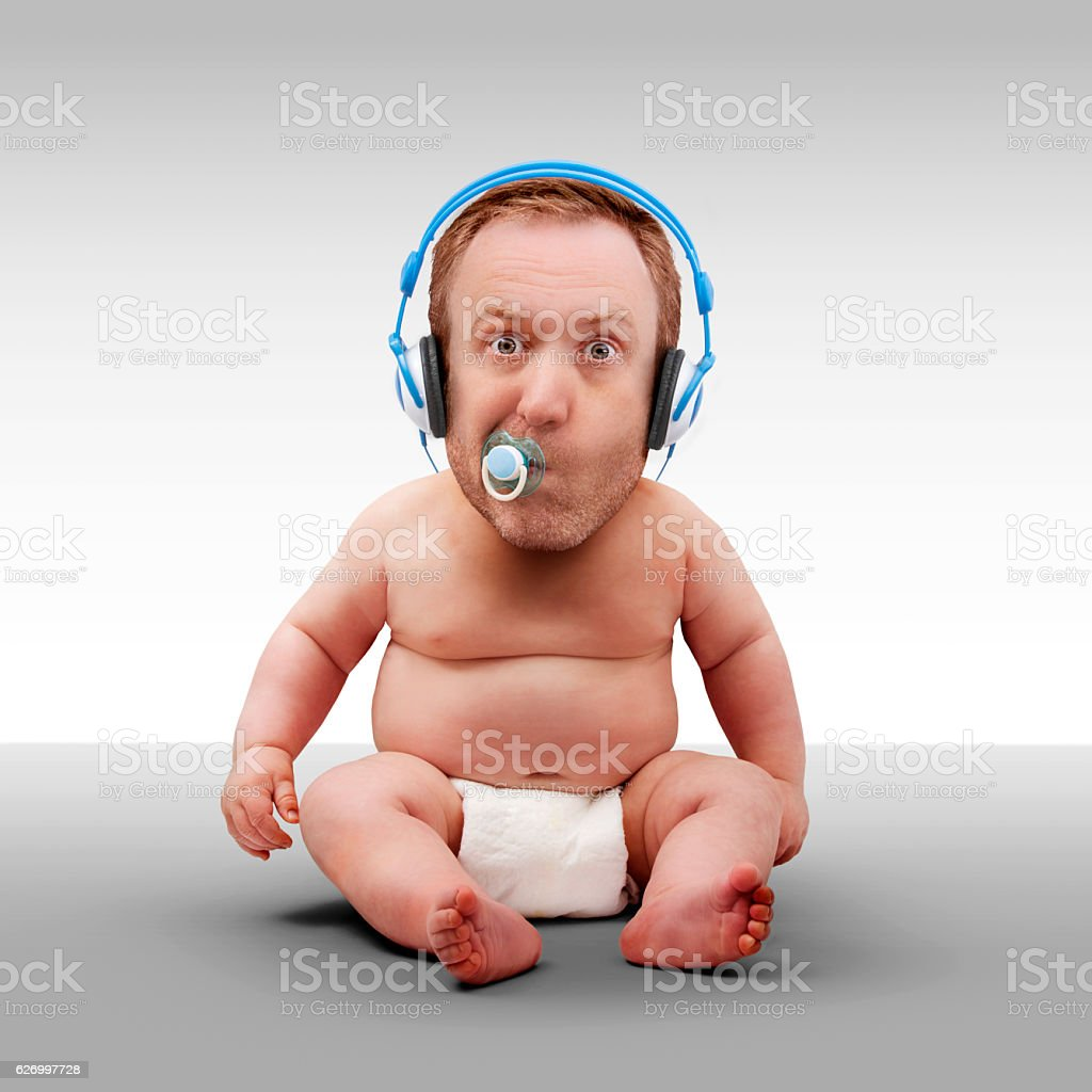 Man Baby Wearing Headphones A studio shot of a baby in a nappy, with an adult male head, wearing headphones and a dummy.  Adult Stock Photo