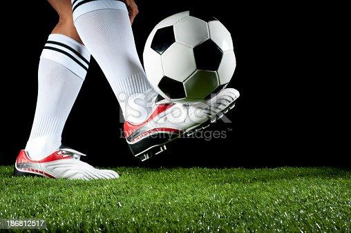 istock Man balancing a soccer ball 186812517