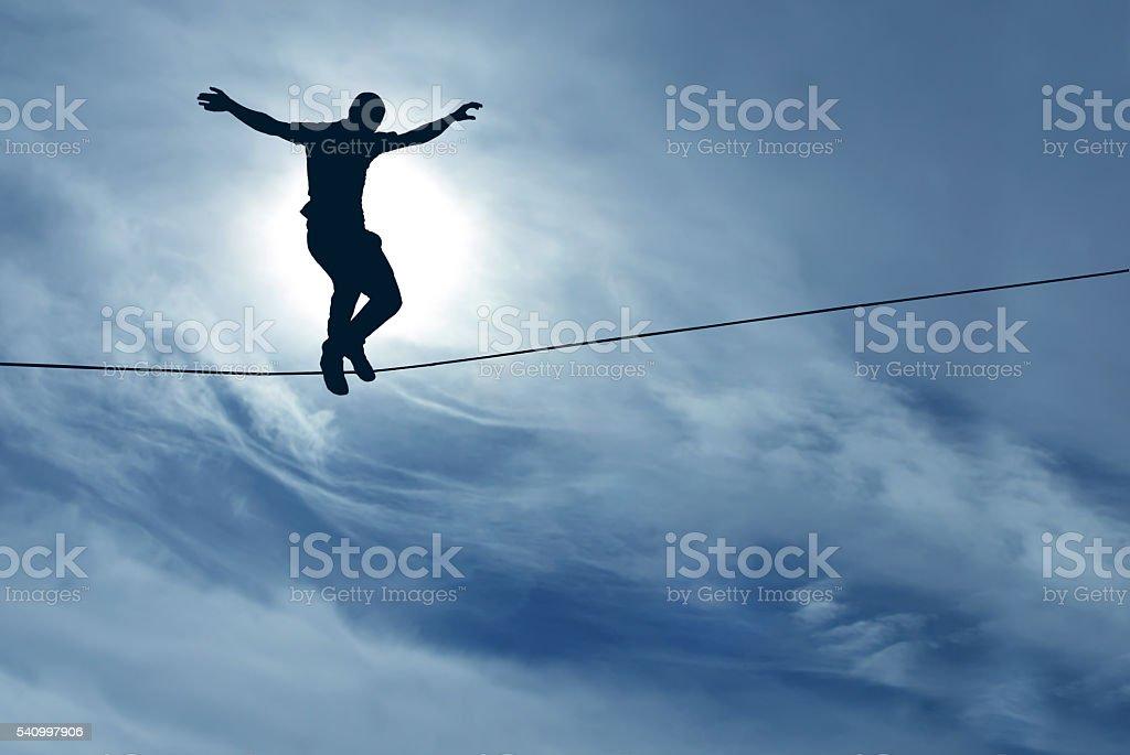 Man balancing on the rope stock photo