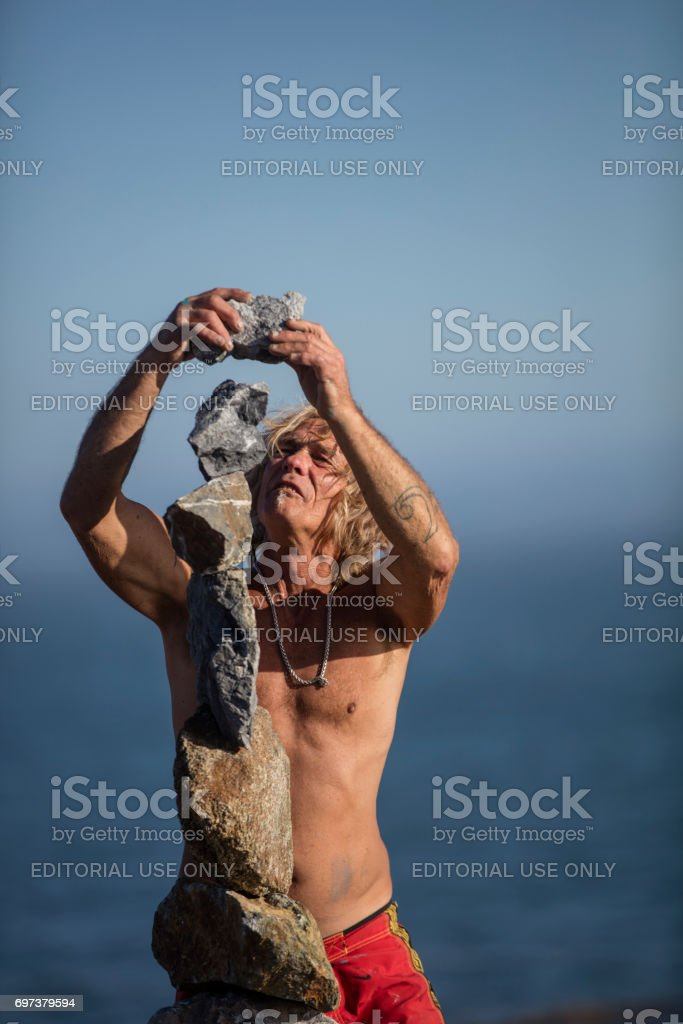Man Balancing Rocks at Santa Cruz, California stock photo