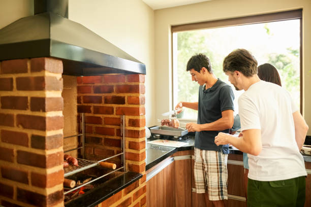 Man barbecuing with friends stock photo