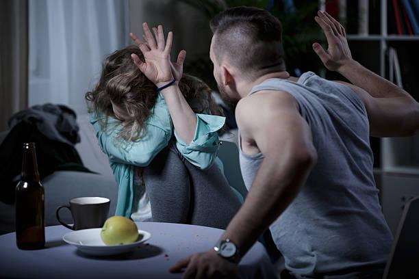 Man beating wife stock photo