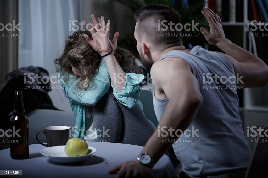Man beating wife stock photo