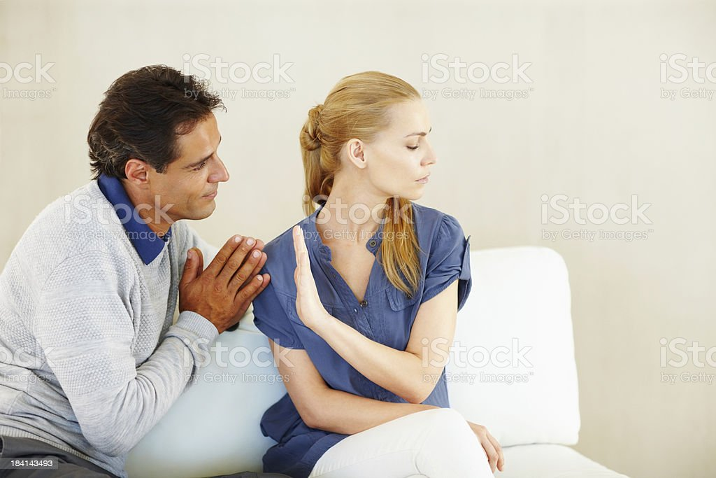 Man begging his wife for forgiveness royalty-free stock photo