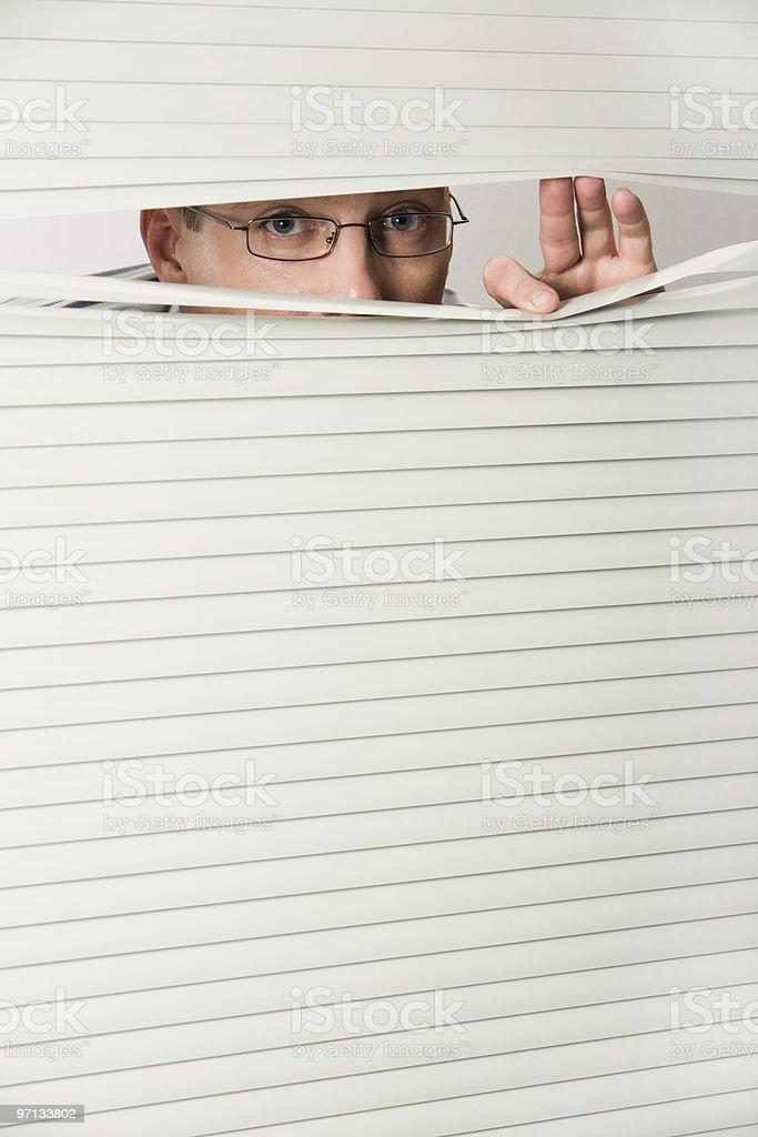 Man behind blind royalty-free stock photo
