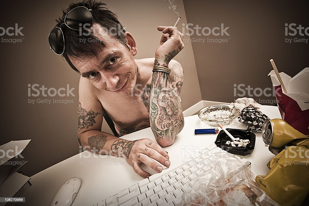 Man behind keyboard on the Internet royalty-free stock photo
