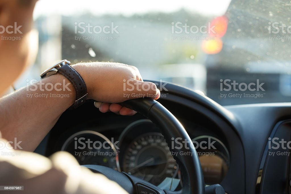 Man behind the wheel in the evening. stock photo