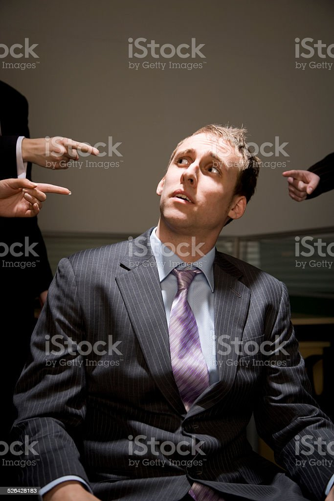 Man Being Accused in Office stock photo