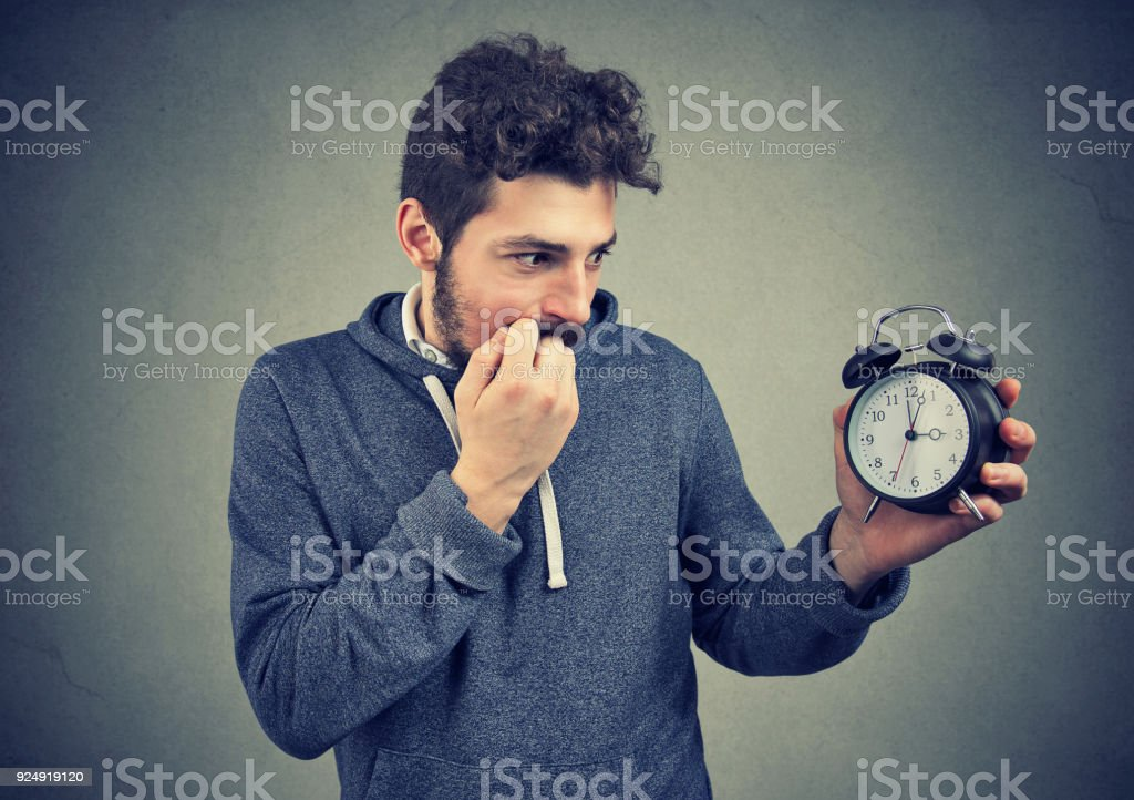 Man being anxious about time pressure stock photo
