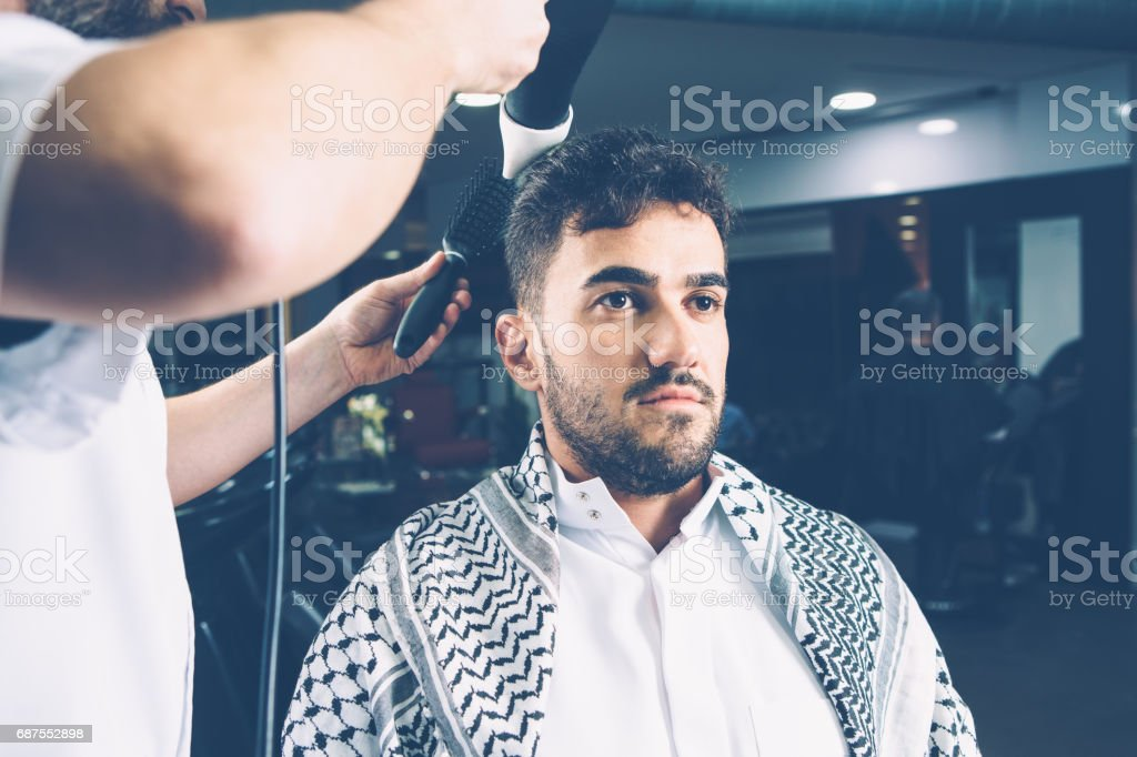 Man being dried in salon - foto stock