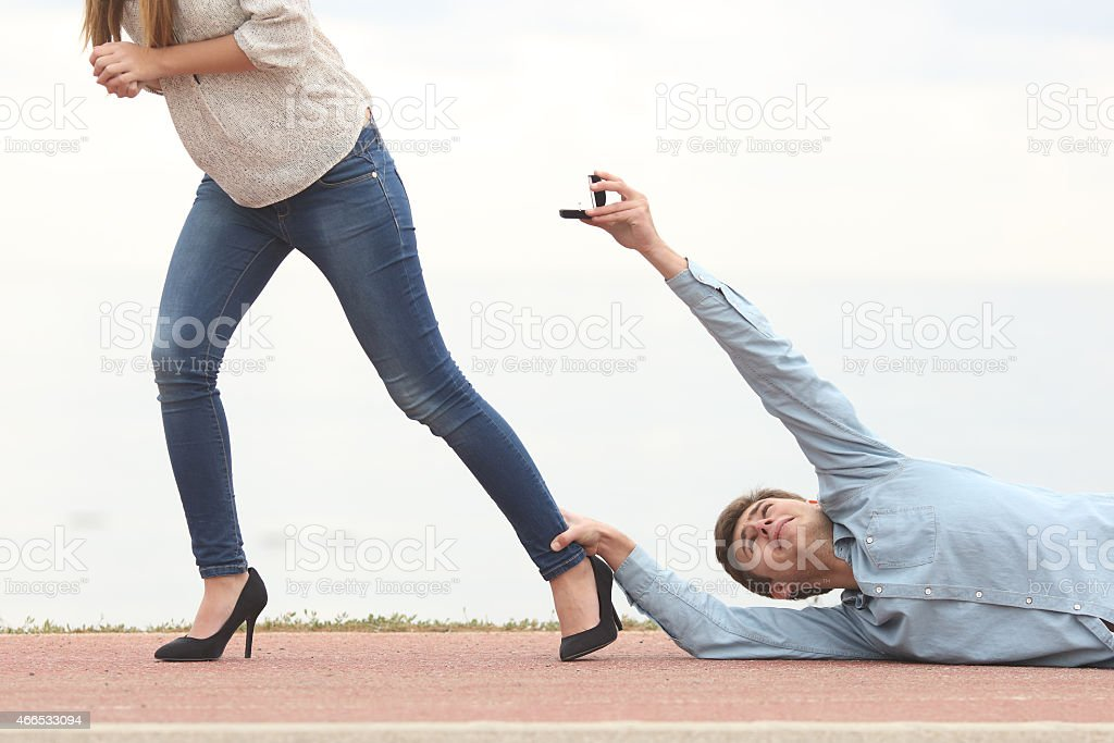 Man being rejected when is proposing marriage stock photo