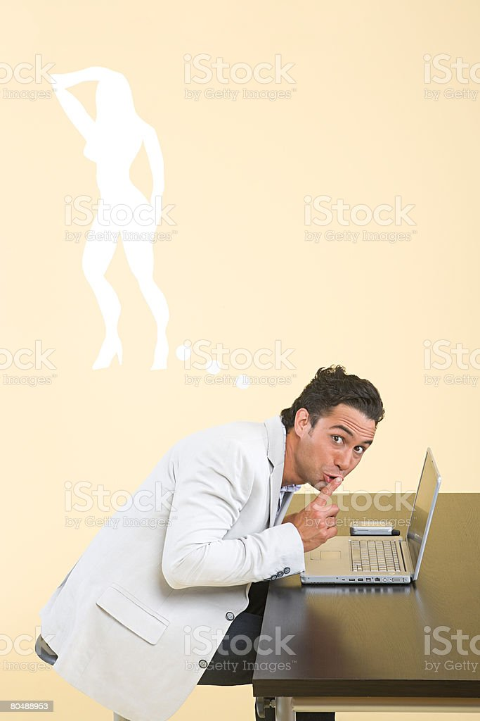 A man being secretive royalty-free stock photo