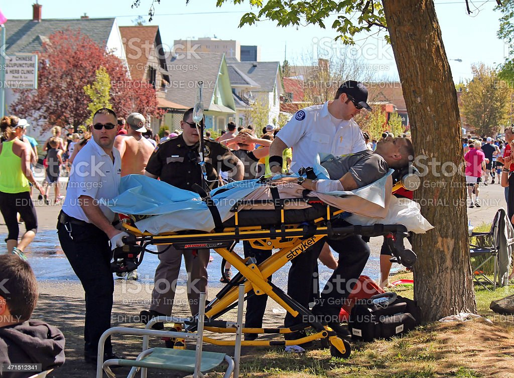 Man Being Treated for Exhaustion by EMTs Bloomsday 2013 stock photo